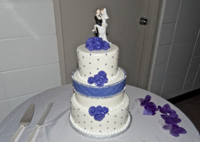 Quilting With Purple Ribbon Roses Wedding Cake