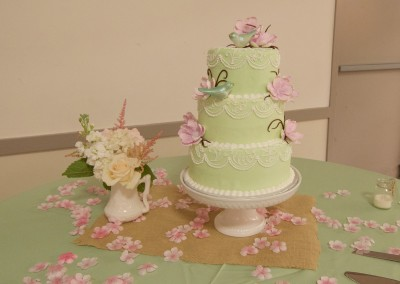 Classic Piping on Green with Flowers Wedding Cake