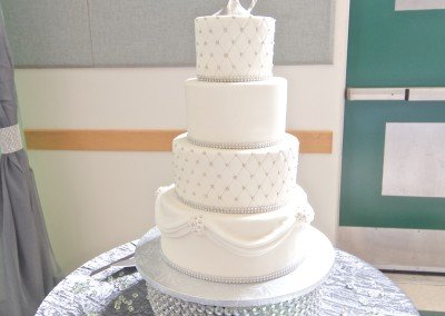 Two Hearts on Elegant White and Silver Wedding Cake