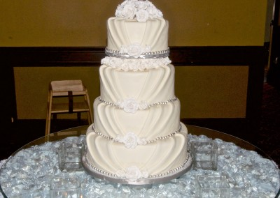 Draping with Bling and Roses Wedding Cake