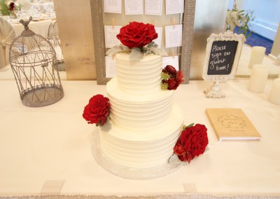 Spatula Swirl and Real Red Roses Wedding Cake